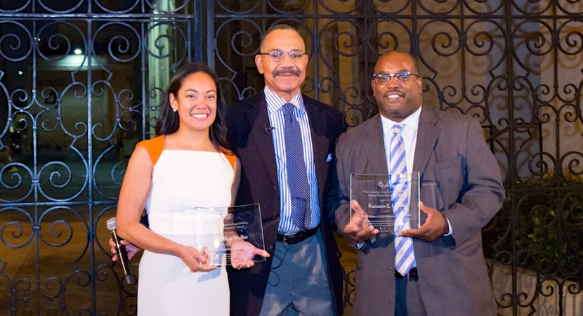 Rick Palmore, Founding Chair of LCLD, presents the 2018 Rick Palmore Award to Merisa Heu-Weller and Kassem Lucas. (Photo by Jay Haas)