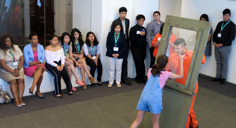 Students with Chicago's inner-city Albany Park Theater Project perform a one-act play about the threat of deportation, after a community service session in which Alumni taught networking skills to the students. (Photo by Don Belt)