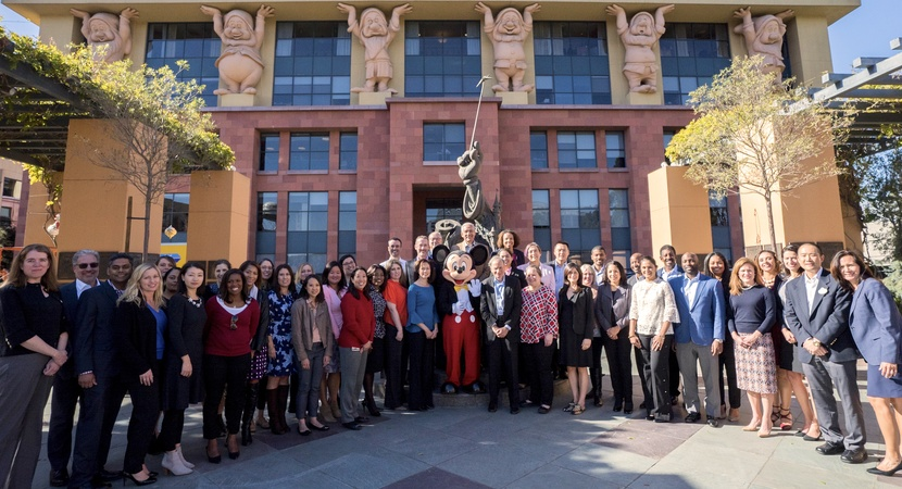 Alan Braverman (center, in gray suit) and Mickey Mouse welcomed three dozen LCLD Fellows to The Walt Disney Company for the final Learning Experience of 2017. (Photo courtesy The Walt Disney Company)