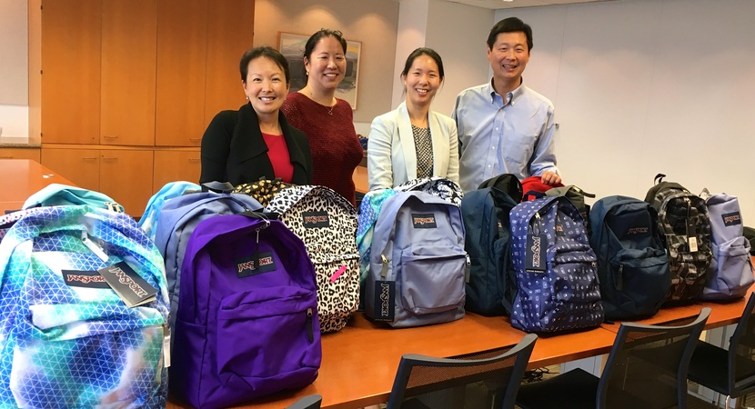 San Francisco Fellows Alumni with donated backpacks full of school supplies.