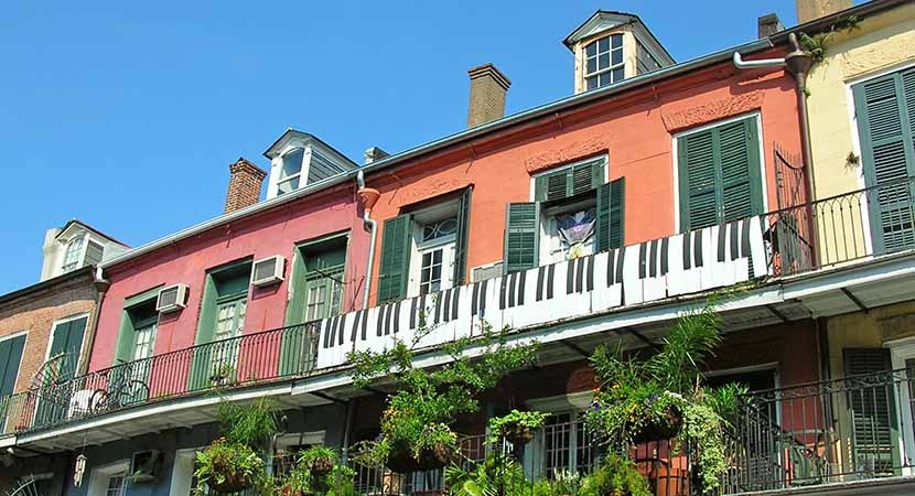 Jazzy and upbeat, the spirit of New Orleans salutes passersby from a balcony overlooking the French Quarter.