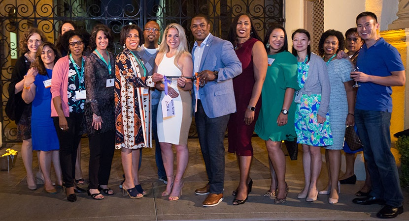 "Members of the Fellows Alumni Class of 2012 with the ""Participation is Key"" Award for ""All In!"" Campaign contributions, 2018. (Photo by Jay Haas)"